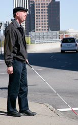 Photo of blind person with cane