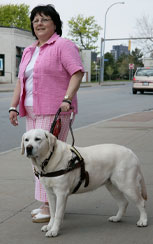 Photo of woman with seeing eye dog